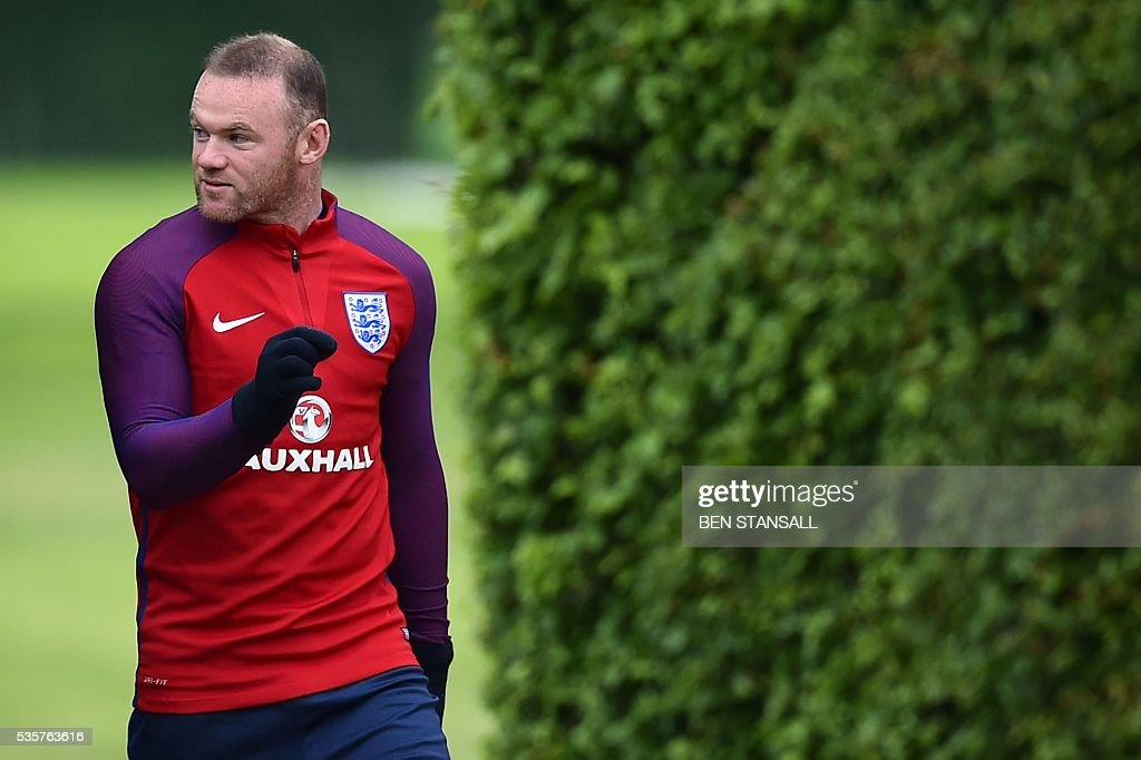 England's striker Wayne Rooney attends a team training session in Watford, north of London, on May 30, 2016. England play against Portugal in a friendly match at London's Wembley Stadium on Thursday June 2, 2016. / AFP / BEN