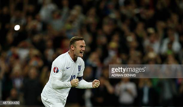 England's striker Wayne Rooney celebrates after scoring from the penalty spot to score his 50th goal for England making him the country's alltime...