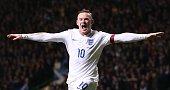 England's striker Wayne Rooney celebrates scoring their third goal during the international friendly football match between Scotland and England at...