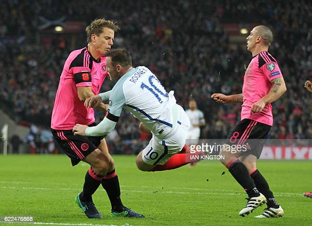 TOPSHOT England's striker Wayne Rooney collides with Scotland's defender Christophe Berra during a World Cup 2018 qualification match between England...