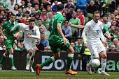England's striker Wayne Rooney controls the ball as Republic of Ireland's defender Marc Wilson closes him down during the international friendly...