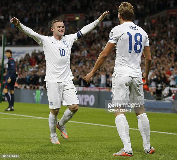England's striker Wayne Rooney reacts as England's Harry Kane celebrates scoring during the Euro 2016 qualifying group E football match between...