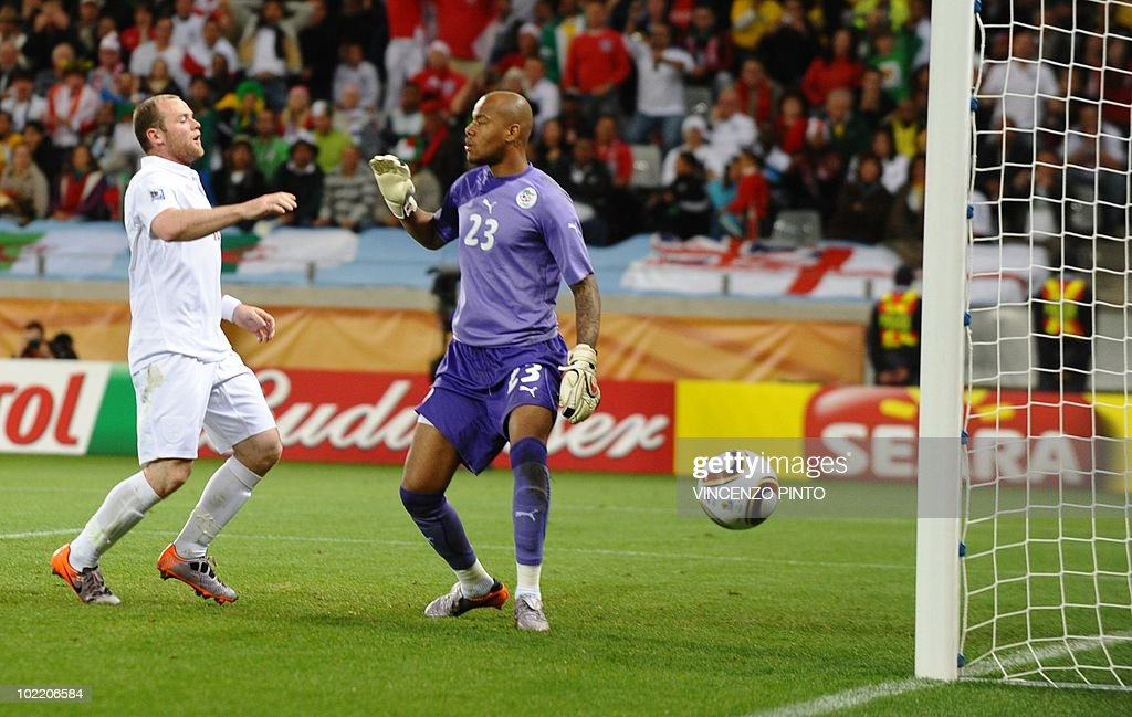 England's striker Wayne Rooney (L) reacts to missing a shot past Algeria's goalkeeper M'bolhi Rais Ouheb during the Group C first round 2010 World Cup football match England vs. Algeria on June 18, 2010 at Green Point stadium in Cape Town. NO
