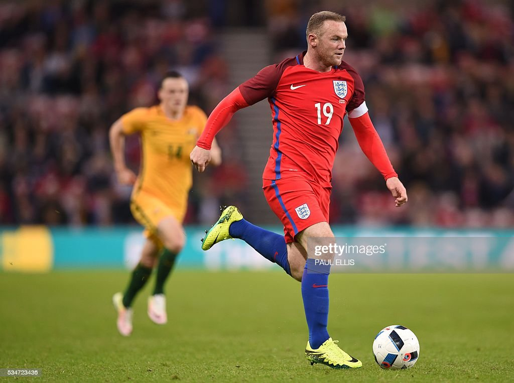 England's striker Wayne Rooney (R) vies for the ball during the friendly football match between England and Australia at the Stadium of Light in Sunderland, north east England, on May 27, 2016. / AFP / PAUL