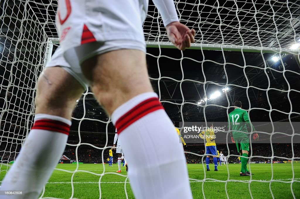 England's striker Wayne Rooney walks behind the goal to retrieve the ball during the international friendly football match between England and Brazil at Wembley Stadium in north London on February 6, 2013. England won 2-1.