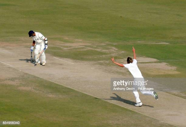 England's Stuart Broad celebrates after bowling out India's Rahul Dravid for 0 during the fourth day of the second test at the Punjab Cricket...