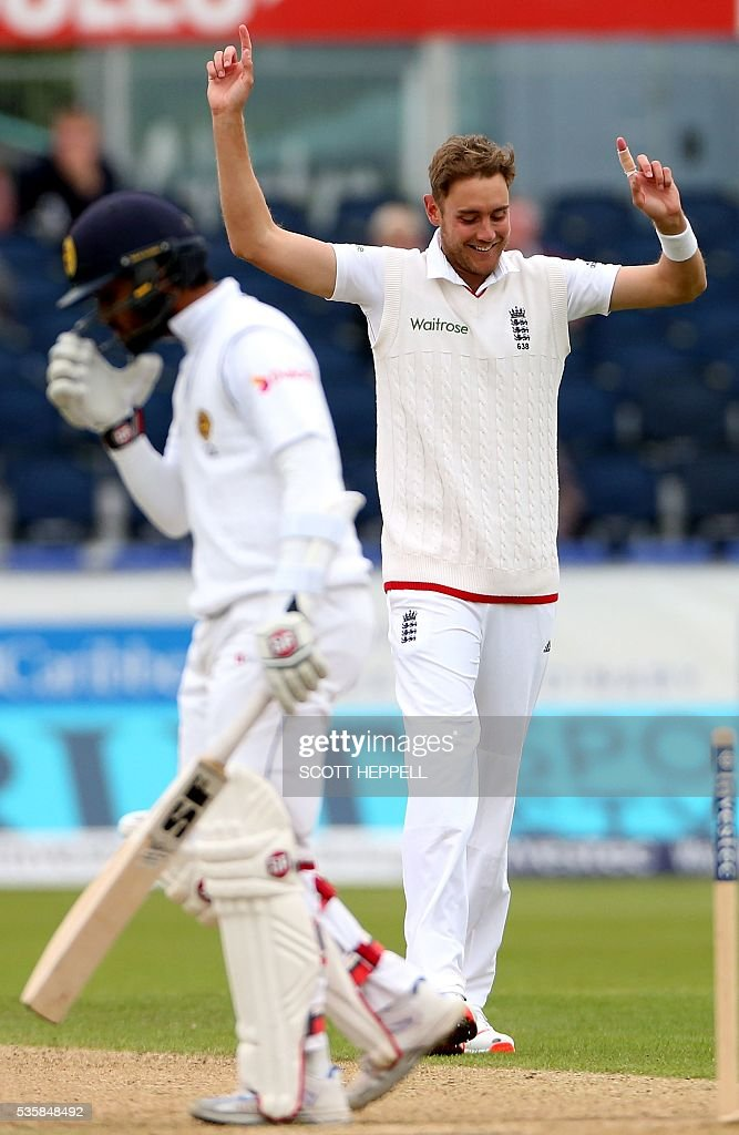 England's Stuart Broad (R) celebrates after bowling out Sri Lanka's Dinesh Chandimal (L) for 126 runs on the fourth day of the second test cricket match between England and Sri Lanka at the Riverside in Chester-le-Street, north east England, on May 30, 2016. / AFP / SCOTT