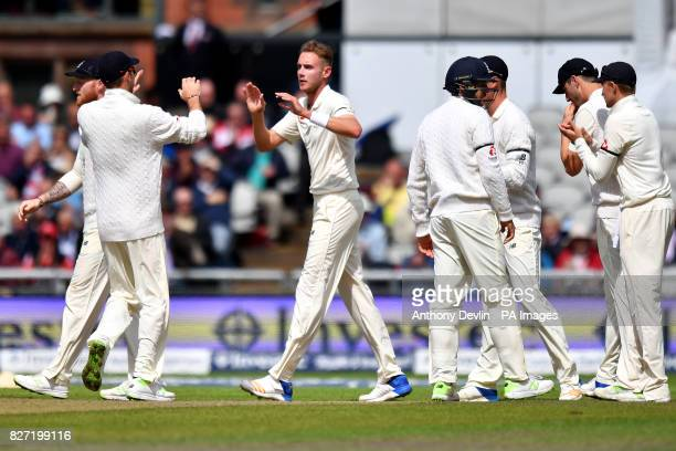 England's Stuart Broad celebrates as South Africa's Dean Elgar is caught behind for 5 runs during day four of the Fourth Investec Test at Emirates...