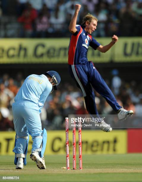 England's Stuart Broad celebrates bowling India's Virender Sehwag during the Second One Day International at the Nehru Stadium in Indore India