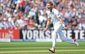 England's Stuart Broad celebrates taking the wicket of Australia's Chris Rogers for 6 runs on the second day of the third Ashes cricket test match...