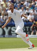 Englands Stuart Broad celebrates taking the wicket of Australias Chris Rogers as Australia lose their first wicket during play on the fourth day of...