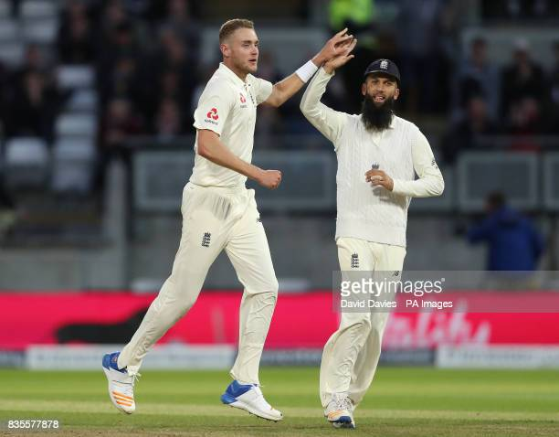 England's Stuart Broad celebrates taking the wicket of West Indies Shane Dowrich with Moeen Ali during day three of the First Investec Test match at...