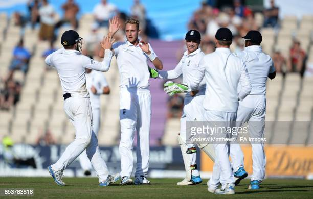 England's Stuart Broad celebrates with his team mates after taking the wicket of India's Bhuvneshwar Kumar during day three of the Third Investec...