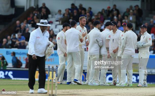 England's Stuart Broad celebrates with team mates after taking the wicket of West Indies' Kyle Hope on the fifth day of the second international Test...