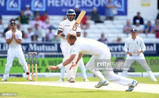 England's Stuart Broad dves in an attempt to catch Sri Lanka's Kumar Sangakkara during day three of the second Investec Test match at Headingley Leeds