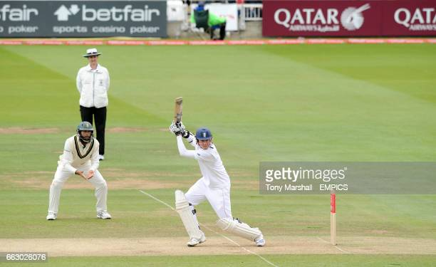 England's Stuart Broad hits out as South Africa's Hashim Amla looks on