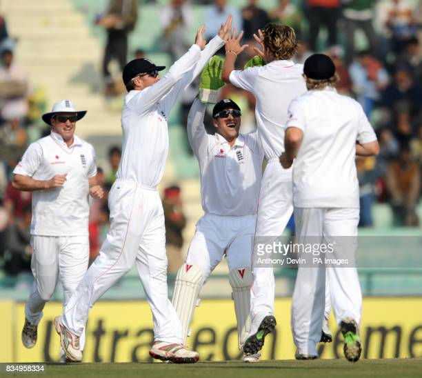 England's Stuart Broad is congratulated after bowling out India's Rahul Dravid for 0 during the fourth day of the second test at the Punjab Cricket...
