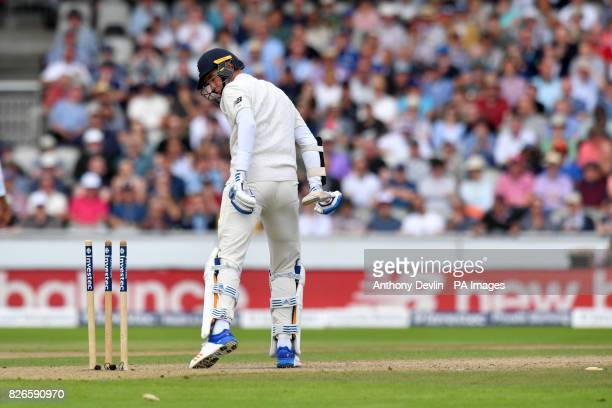 England's Stuart Broad looks at his stumps after being bowled out by South Africa's Morne Morkel during day two of the Fourth Investec Test at...