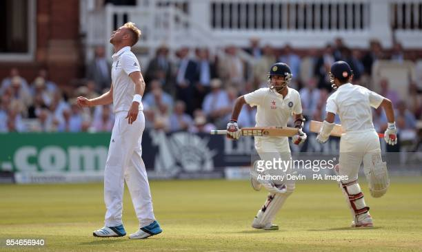 England's Stuart Broad reacts as India's Ajinkya Rahane and Bhuvneshwar Kumar run between the wickets during day one of the second test at Lord's...