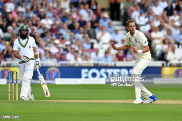 England's Stuart Broad reacts as South Africa's Hashim Amla appears to be caught behind but remains at the crease after England fail to appeal for...