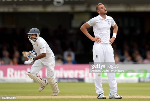 England's Stuart Broad reacts as Sri Lanka's Kumar Sangakkara runs between the wickets during day three of the Investec Test match at Lord's Cricket...