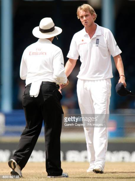 England's Stuart Broad talks to umpire Daryl Harper during the fifth test at Queen's Park Oval Port of Spain Trinidad