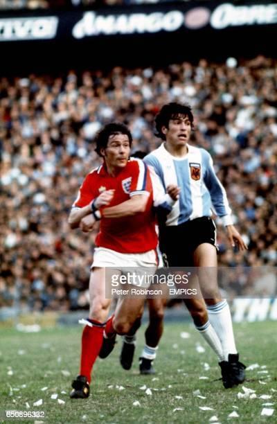 England's Stuart Pearson and Argentina's Daniel Passarella