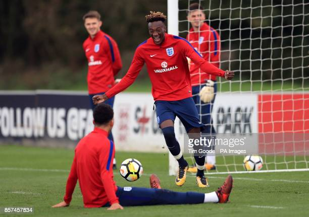 England's Tammy Abraham and Dominic Solanke celebrate a goal during the training session at St George's Park Burton