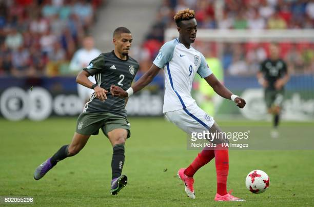 England's Tammy Abraham and Germany's Jeremy Toljan battle for the ball during the UEFA European Under21 Championship Semi Final match at Stadion...