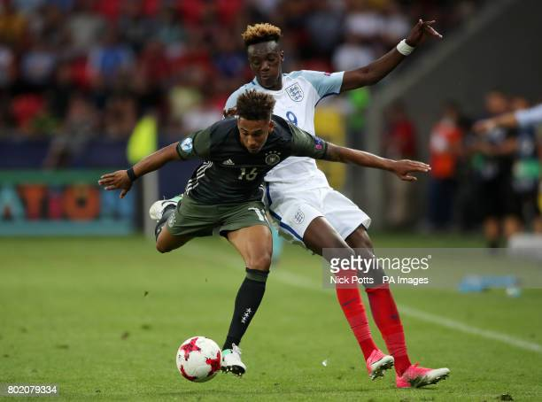England's Tammy Abraham and Germany's Thilo Kehrer battle for the ball during the UEFA European Under21 Championship Semi Final match at Stadion...
