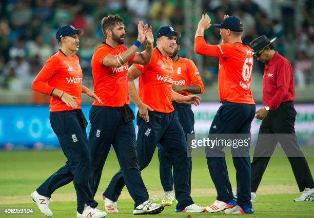 England's team members celebrate the dismissal of Pakistan's Shoaib Malik during the second T20 cricket match between Pakistan and England at the...