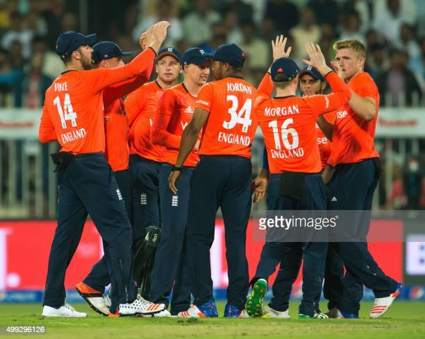 England's team players celebrate the dismissal of Pakistan's Ahmed Shehzad during the third T20 cricket match between Pakistan and England at the...