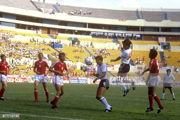 England's Terry Butcher and Terry Fenwick attack the Polish goal watched by Poland's Zbigniew Boniek Roman Wojcicki Stefan Majewski and Ryszard...