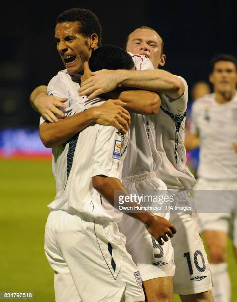 England's The Walcott celebrates his goal with Rio Ferdinand and Wayne Rooney during the World Cup Qualifying Group Six match at the Stadion...