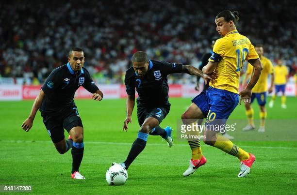 England's Theo Walcott and Glen Johnson combine to deny Sweden's Zlatan Ibrahimovic