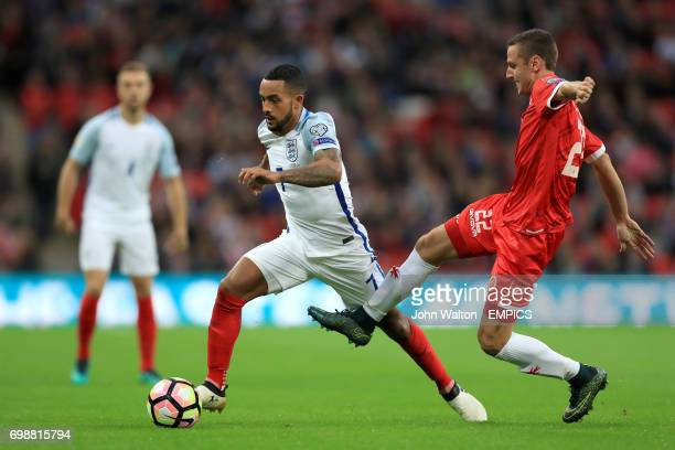 England's Theo Walcott and Malta's Alex Muscat battle for the ball