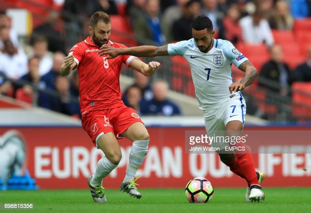 England's Theo Walcott and Malta's Paul Fenech battle for the ball