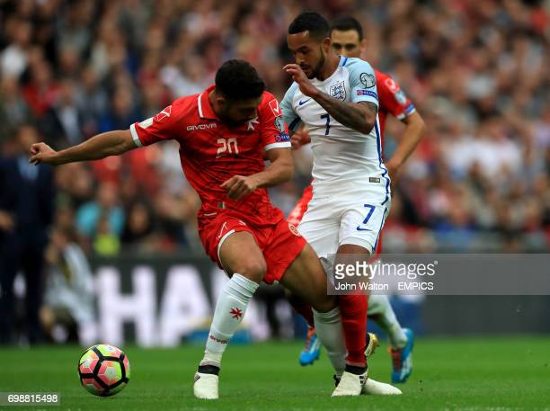 England's Theo Walcott and Malta's Zach Muscat battle for the ball