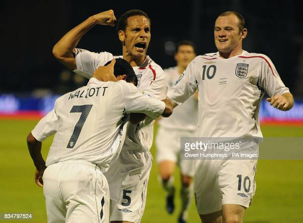 England's Theo Walcott celebrates his goal with Rio Ferdinand and Wayne Rooney during the World Cup Qualifying Group Six match at the Stadion...