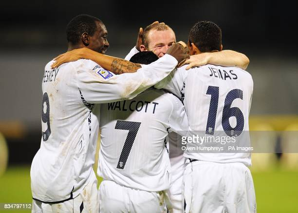 England's Theo Walcott celebrates with his team mates after scoring the fourth goal