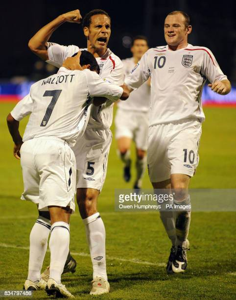 England's Theo Walcott celebrates with Rio Ferdinand and Wayne Rooney after scoring during the World Cup Qualifying Group Six match at the Stadion...
