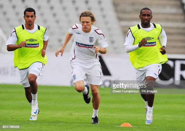 England's Theo Walcott Jimmy Bullard and Jemaine Defoe during the training session at the Olympic Stadium Barcelona