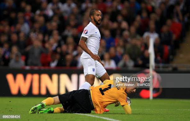 England's Theo Walcott looks on as he scores the opening goal of the game as Estonia's goalkeeper Mihkel Aksalu looks on dejected