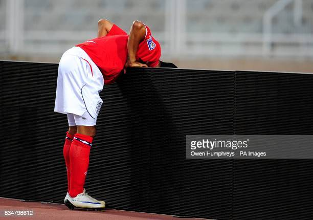 England's Theo Walcott looks over the advertising boards