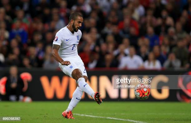 England's Theo Walcott scores the opening goal of the game