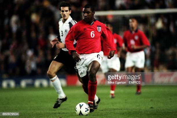England's Titus Bramble is tracked by Germany's Christoph Metzelder