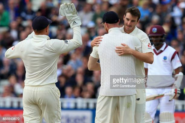 England's Toby RolandJones celebrates with teammates after dismissing West Indies batsman Kyle Hope during play on day 3 of the first Test cricket...