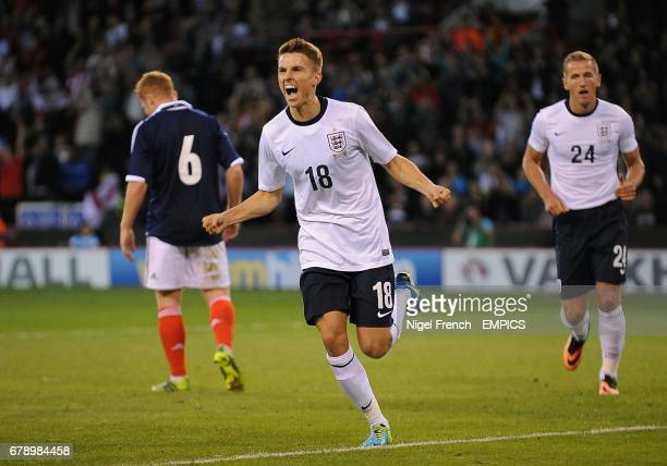 England's Tom Carroll celebrates after scoring his sides sixth goal against Scotland