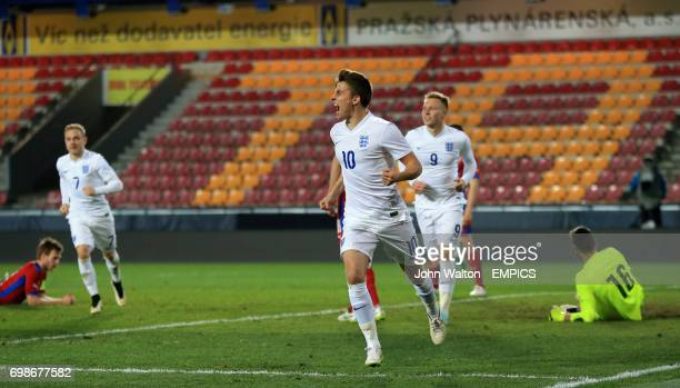 England's Tom Carroll celebrates scoring the opening goal of the game