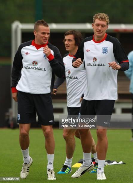 England's Tom Cleverley and Phil Jones during the training session at London Colney Hertfordshire